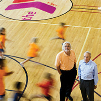 page spread photograph of Jeffry Cadorette and Bill Strine at Rocky Run YMCA